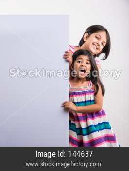 Indian small girls holding blank white board