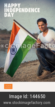 Handsome Indian Man holding national flag or Tricolour