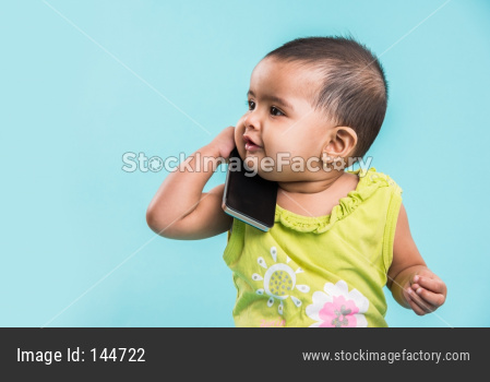 Small Indian Infant calling using smartphone / mobile