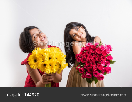 Small girls holding flower bouquet / bunch of flowers