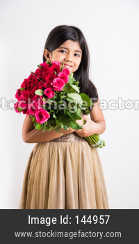 Small girl holding flower bouquet / bunch of flowers