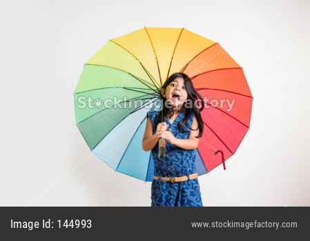 Indian Girl with big multicoloured umbrella, isolated over white