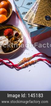 Happy Raksha Bandhan /Rakhi Greeting Card using Designer thread, Diya, Pooja Thali, Gift box, Indian Paper Currency notes and sw