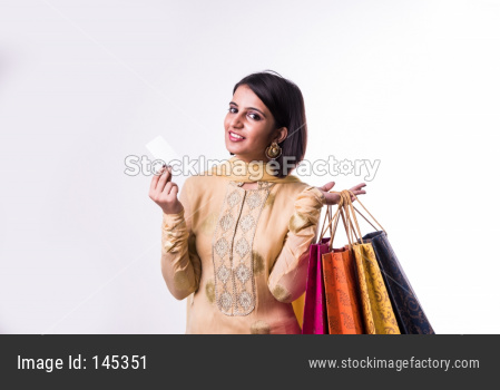 Girl with shopping bags and debit / credit card
