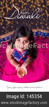Diwali Greeting Card showing small Girl Holding Diya or oil lamp