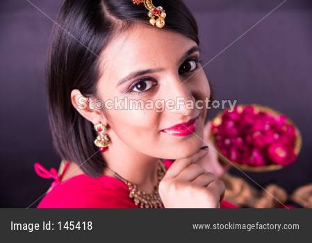 Girl holding a plate full of Rose flower / petals
