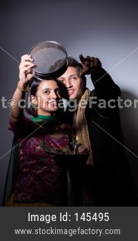 couple celebrating karwa chauth festival