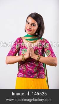 Young girl in prayer pose or welcome pose with closed hands