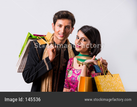 Indian young couple holding shopping bags