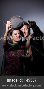 couple celebrating karwa chauth festival