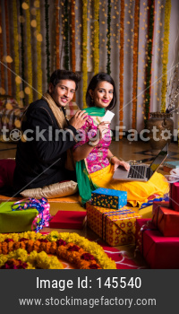 Indian young couple online shopping on diwali / anniversary