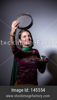 Young wife celebrating karwa chauth festival