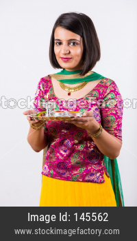 Girl Holding pooja thali / plate