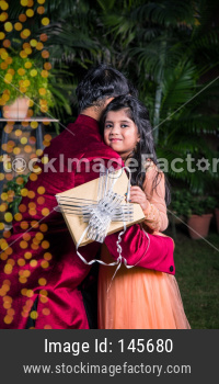 Indian father and daughter celebrating diwali festival