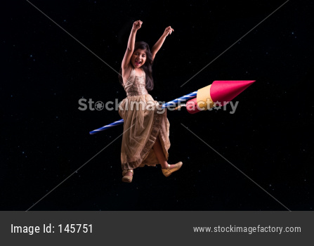Concept showing cute indian girl riding on Diwali Rocket and travelling to space
