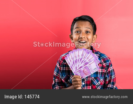 Kid/boy holding Currency note fan of rupees 2000