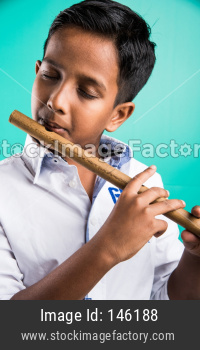 Little indian playing Flut / Basuri / Musical Instrument
