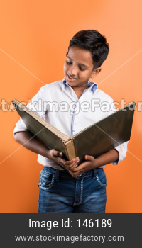 School kid reading big book