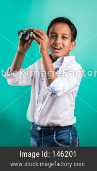 School kid looking through binocular