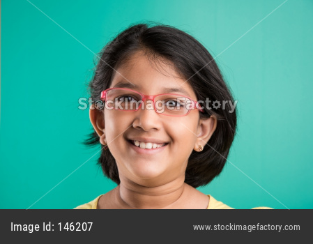 cute little happy Indian girl wearing clear glasses or Spectacles