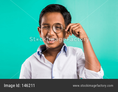 School kid with magnifying glass
