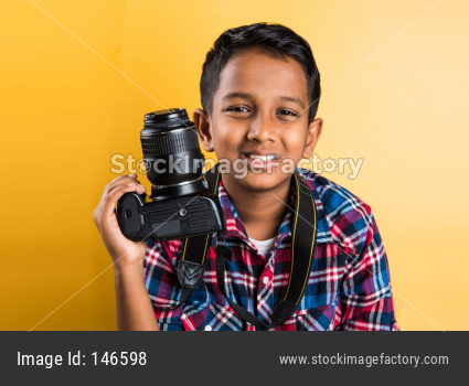 Small boy using laptop computer