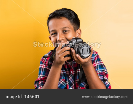 small boy taking pictures with Digital Camera