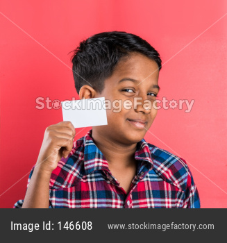 indian kid holding white card, indian boy and card, indian kid or indian boy with white card or banner, red background, smart bo