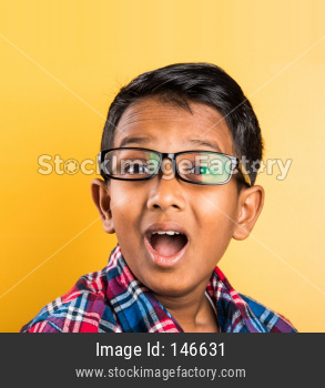 Small boy wears clear eye glasses or spectacles