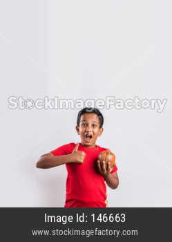 Indian kid catching falling currency notes