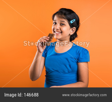 Small girl eating chocolate