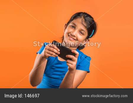 Small Girl using smartphone for playing game or taking selfie picture