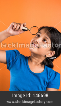 small School girl with magnifying glass
