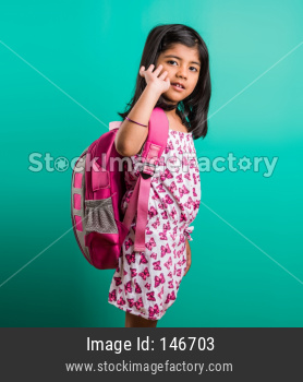 Cute little indian girl with school bag or sack