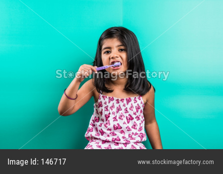 Small girl child brushing teeth