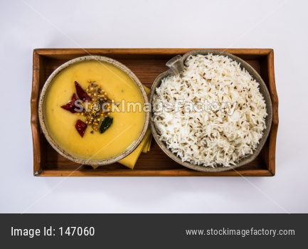 Whole Yellow Lentil dal tadka or fry with Jeera Rice, selective focus