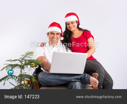Indian young couple celebrating Christmas / X-mas