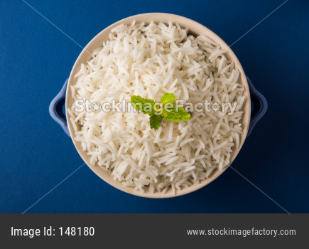 Cooked plain white basmati rice in ceramic bowl