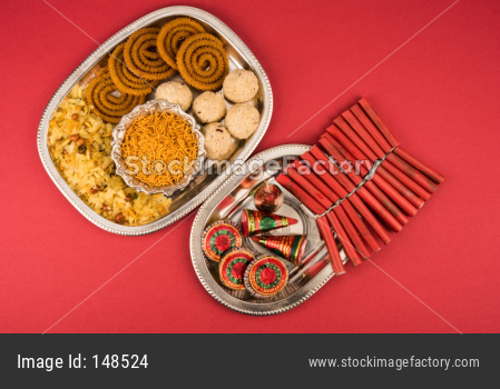 diwali food / snacks /sweets with fire crackers isolated