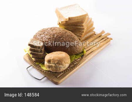 Variety of assorted fresh bread from bakery, served in a basket / tray