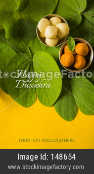 Happy Dussehra greeting card using apta  / Bauhinia racemosa / Bidi leaf with sweet pedha / peda / pera