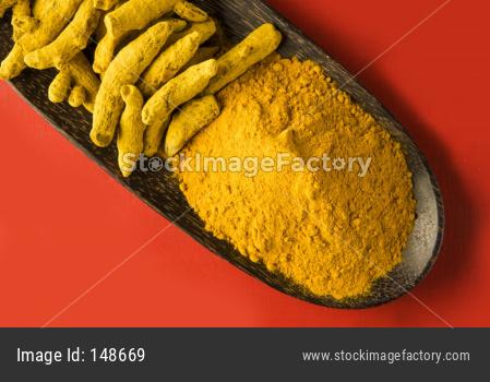 whole turmeric and haldi or huldi powder heap