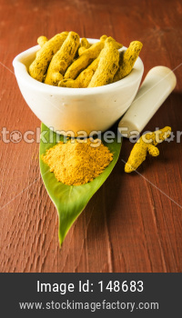 whole turmeric and haldi or huldi powder heap