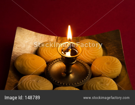 Peda or Pedha sweet food with diya/lamp
