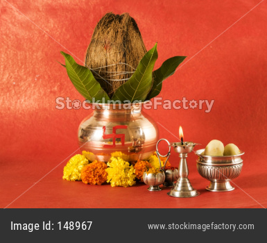 copper kalash with coconut and mango leaf with floral decoration, fruits, diya, sweet pedha,essential in hindu puja, front view,
