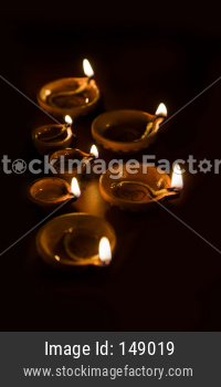 Diwali diyas at night with bokeh of lighting series