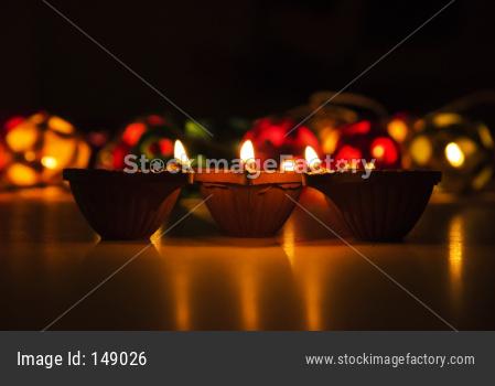 Diwali diyas at night with bokeh of lighting series
