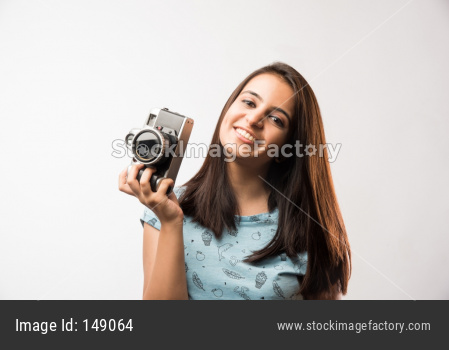 Young beautiful indian girl holding antique Photography camera