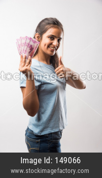 beautiful young girl holding money fan