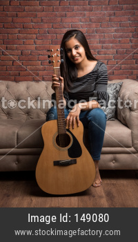 Attractive young girl with Guitar